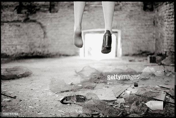 woman's feet missing one shoe in abandoned building - suicide stock photos and pictures