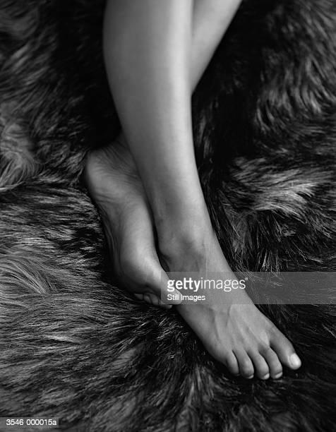 Woman's Feet on Rug