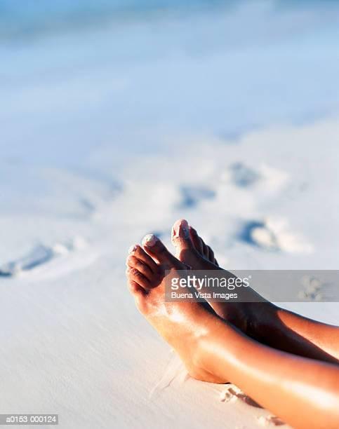 Woman's Feet on White Sand