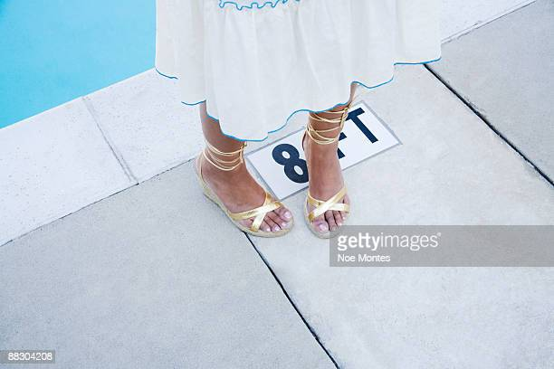 woman's feet - gold sandals stock pictures, royalty-free photos & images