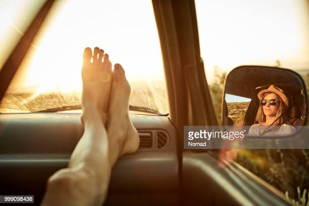 woman's feet relaxing on dashboard of mini van - dashboard stock pictures, royalty-free photos & images