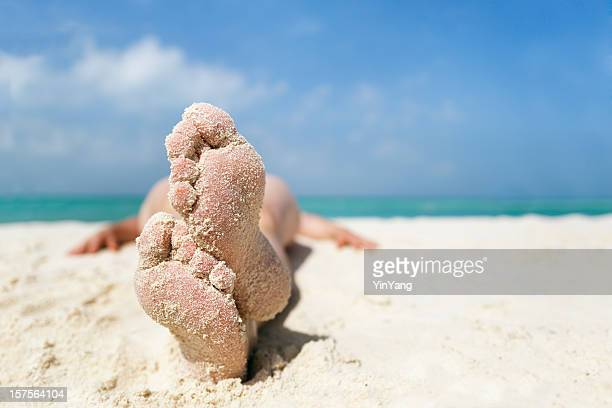 woman's feet relaxing, sunbathing on beach sand vacation, cancun, mexico - mayan riviera stock photos and pictures
