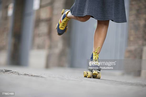 woman's feet rollerskating - skirt stock pictures, royalty-free photos & images