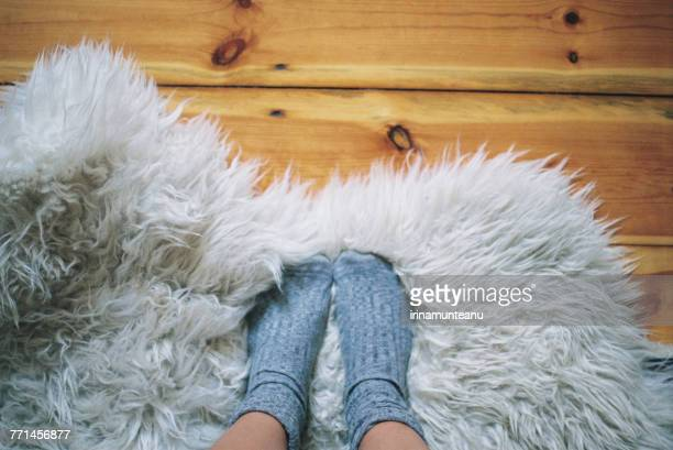 womans feet wearing socks on a rug - white women feet stock pictures, royalty-free photos & images