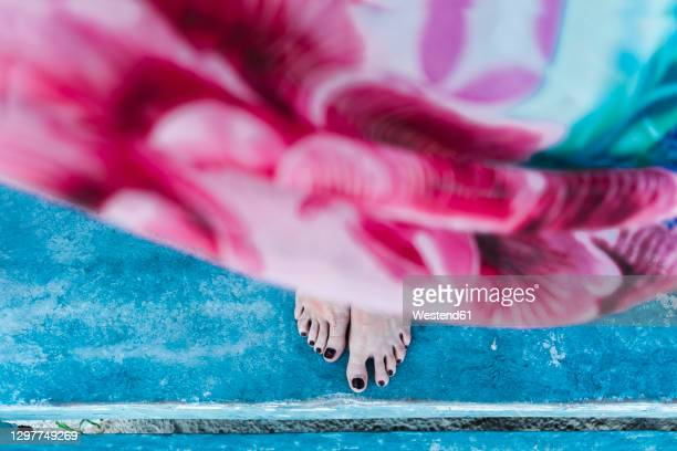 woman's feet with black nail polish on shabby floor at cabin - black nail polish stock pictures, royalty-free photos & images