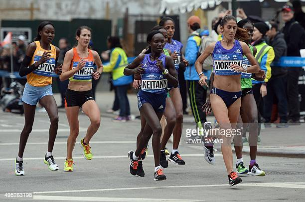 Woman's first place finisher Mary Keitany runs with others during the TCS New York City Marathon in New York on November 1 2015 Keitany won the New...