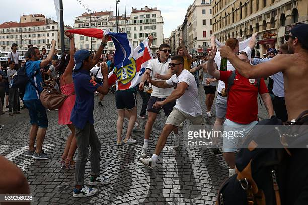 A woman's flag is grabbed by England fans chant outside a pub in Marseille ahead of the opening game of the UEFA Euro 2016 tournament later today on...
