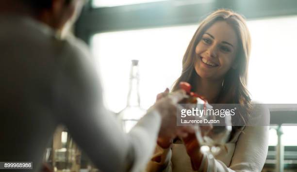 woman's gift at table. - giving stock photos and pictures