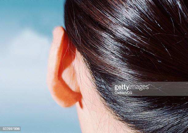 woman's hair and earlobe - earlobe stock photos and pictures