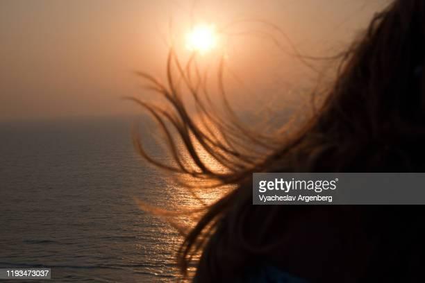 woman's hair at sunset, orange color, goa - argenberg bildbanksfoton och bilder