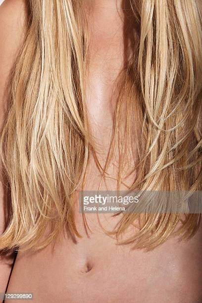 WomanÍs hair covering her breasts