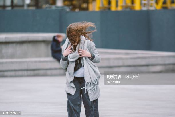 A woman's hair gets blown in the wind upon Storm Sabine arrival on February 9 2020 in Cologne Germany