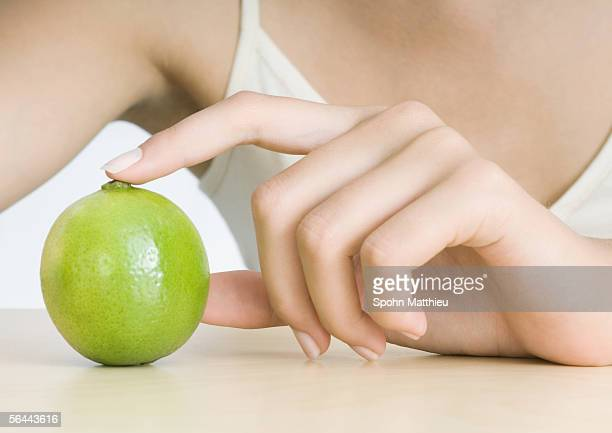 Woman's hand and lime