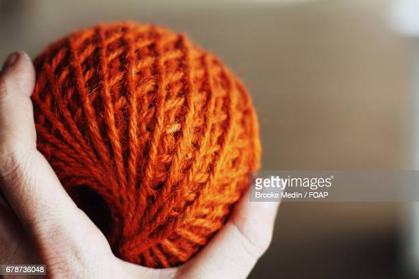 Woman's hand holding ball of wool
