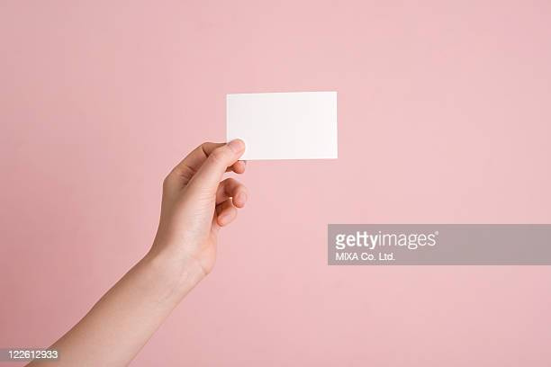 Woman's hand holding card