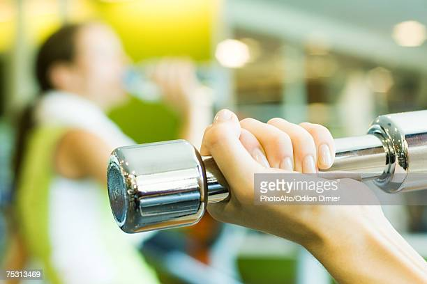 Woman's hand holding dumbbell, close-up