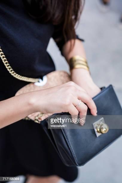 Woman's hand holding handbag