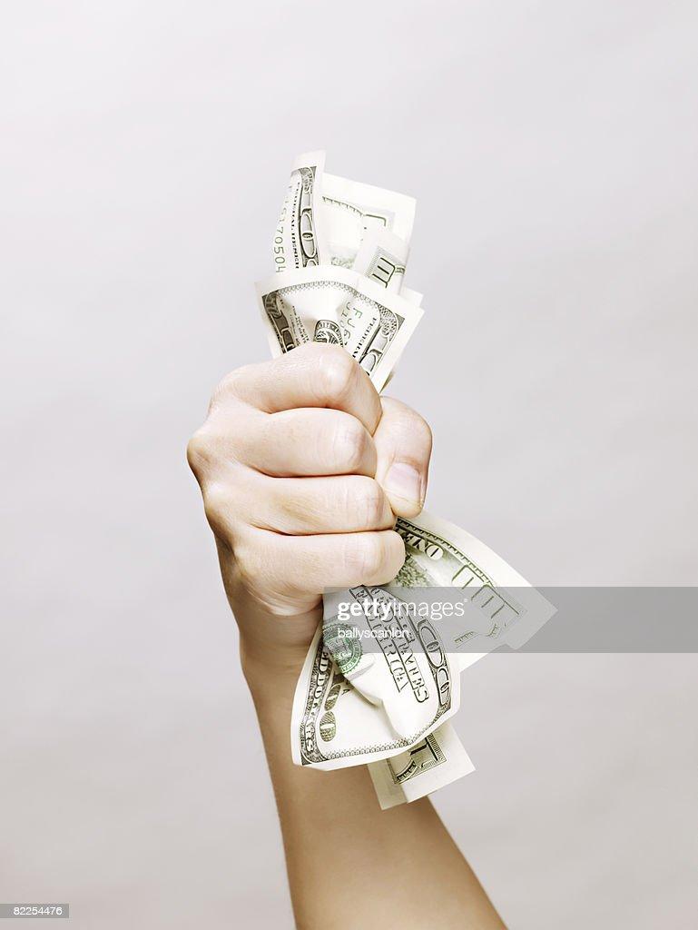 Woman's hand holding one hundred dollars bills : Stock Photo