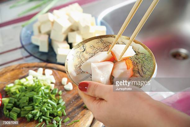 Woman?s hand holding plate of prepared food