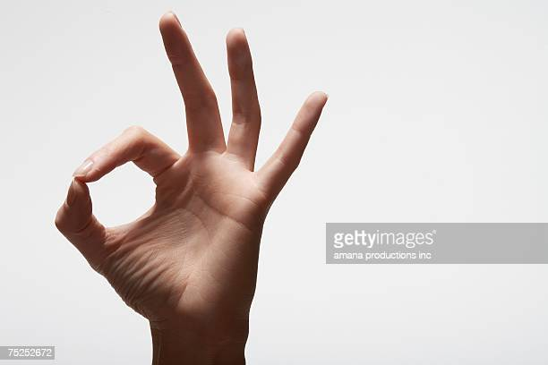 Woman's hand making 'OK'  sign (close-up)