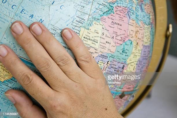 Woman's Hand on a Globe