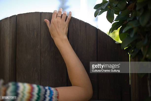 Woman's hand on gate