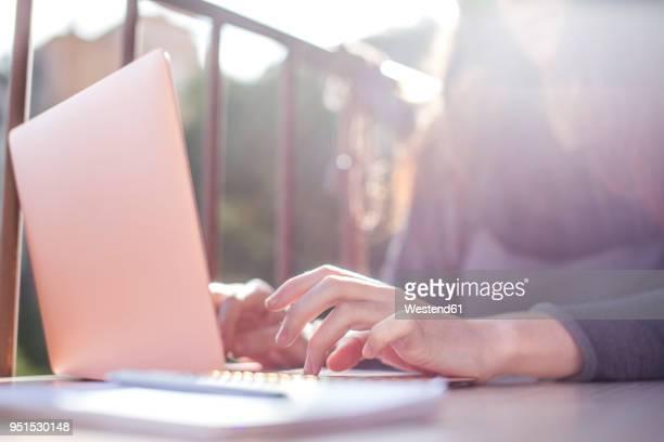 woman's hand on laptop keyboard - convenienza foto e immagini stock