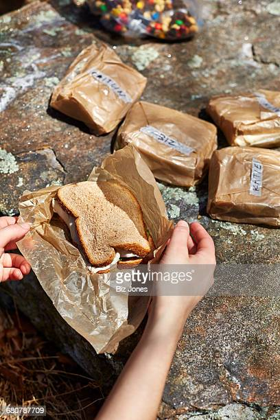 Womans hand opening named sandwiches in Harriman State Park, New York State, USA