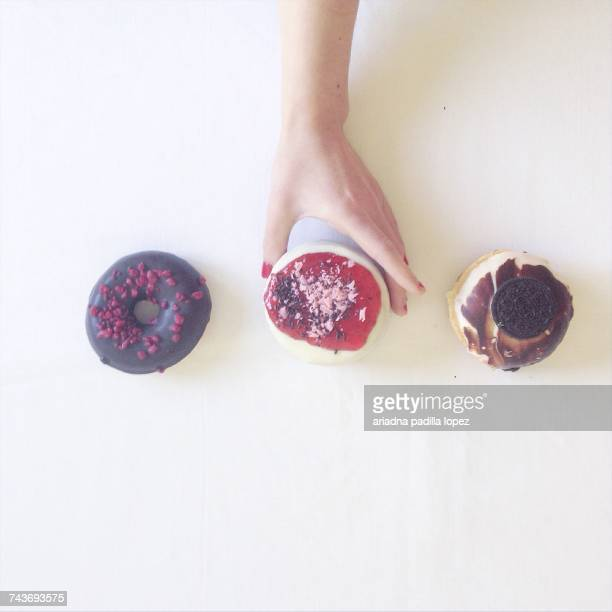 Womans hand reaching for doughnuts