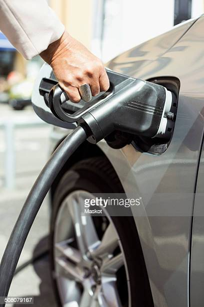Woman's hand refueling car