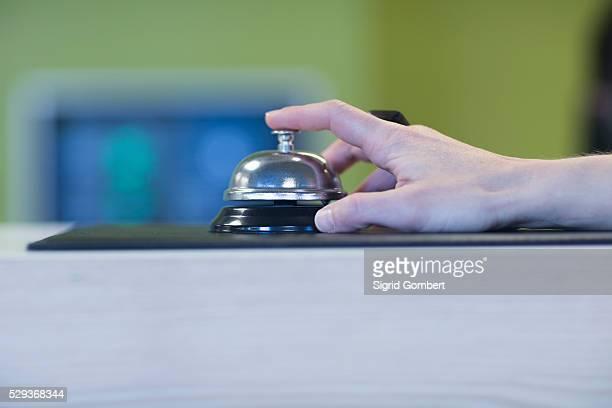 woman's hand ringing bell for service, freiburg im breisgau, baden-w��rttemberg, germany - sigrid gombert fotografías e imágenes de stock