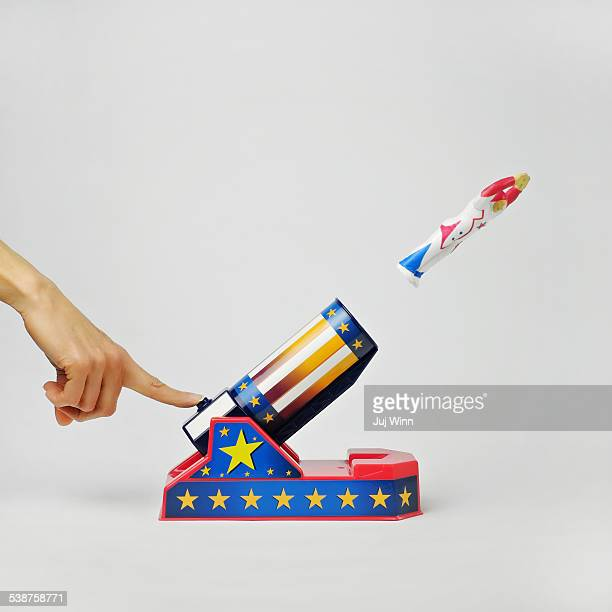 Woman's Hand Shooting Figure Out Of Toy Rocket