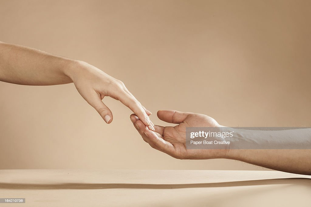 Womans Hand Slipping Away From Mans Hand Stock Photo Getty Images