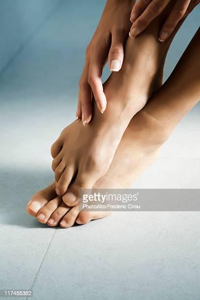 woman's hand touching her bare feet - beautiful bare women fotografías e imágenes de stock