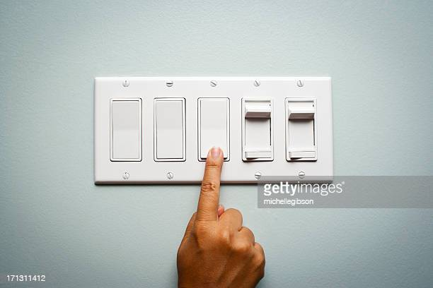 woman's hand turning off the light - push button stock pictures, royalty-free photos & images