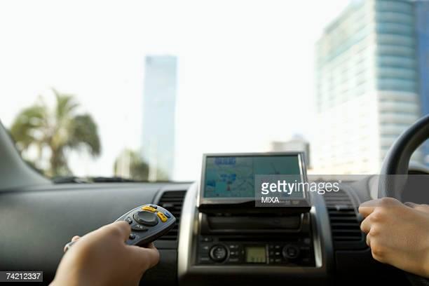 Woman's hand using GPS