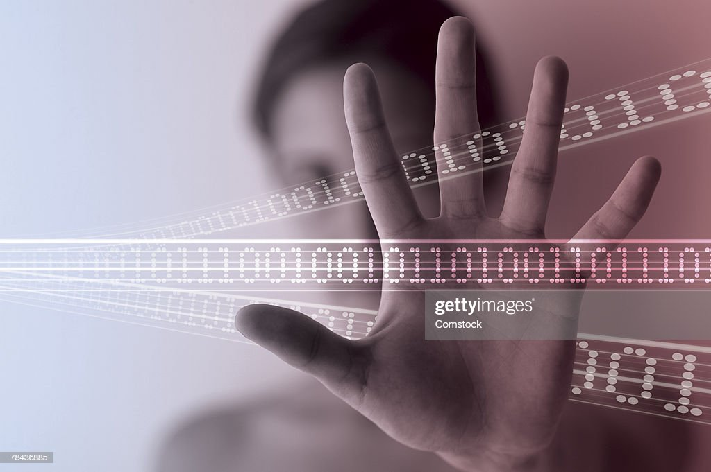 Woman's hand with binary code going through it : Stockfoto