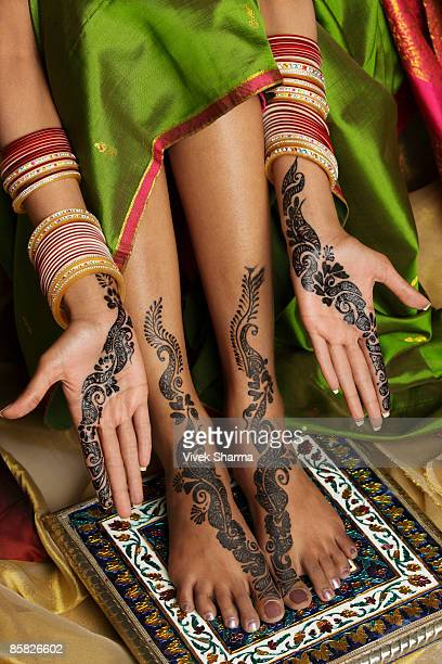 woman's hands and feet painted with henna - pretty asian feet stock photos and pictures