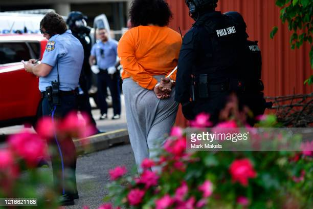 A woman's hands are handcuffed after an arrest during widespread unrest following the death of George Floyd on May 31 2020 in Philadelphia...