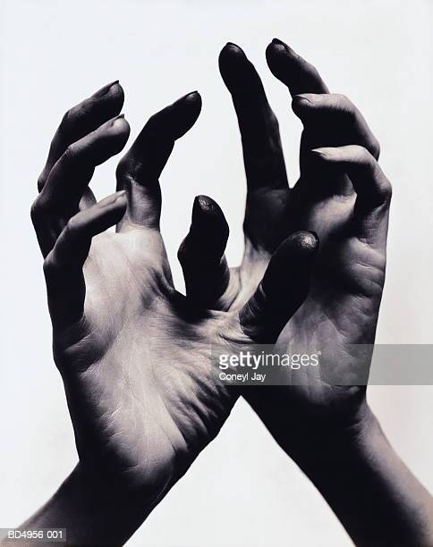 woman's hands, close-up (toned b&w) - coneyl stock pictures, royalty-free photos & images