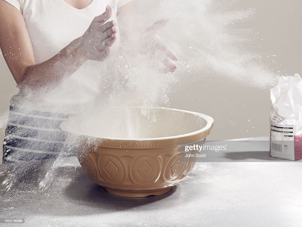 Woman's hands covered in flour while baking : Stock Photo