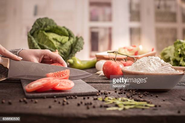 woman's hands cutting tomato - kitchen knife stock photos and pictures