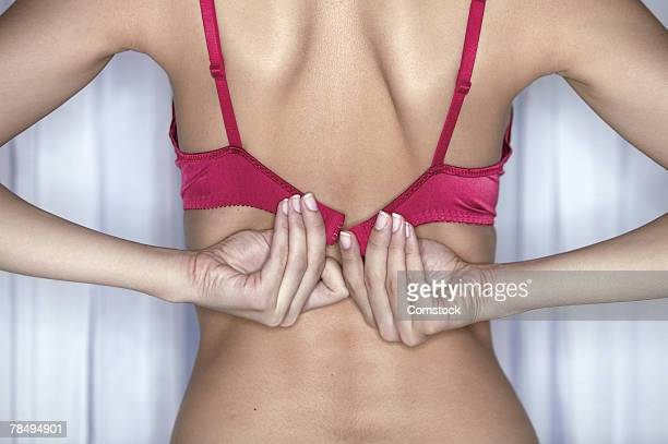woman's hands fastening bra - fastening stock pictures, royalty-free photos & images