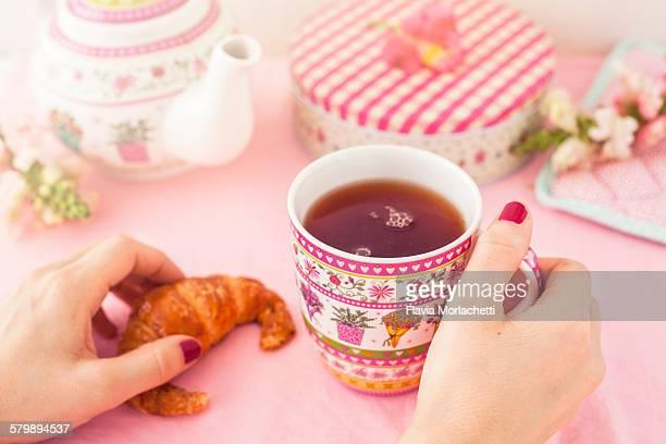 Woman's hands having breakfast