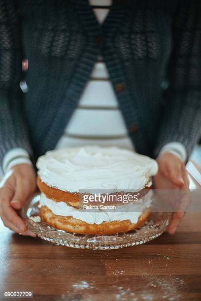 womans hands holding a cake - rekha garton stock pictures, royalty-free photos & images