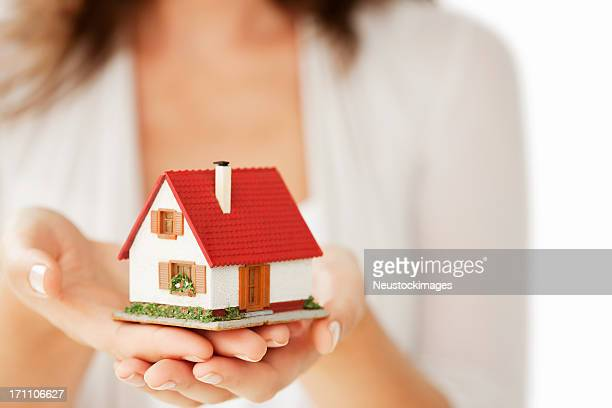 Woman's Hands Holding a Little House - Isolated