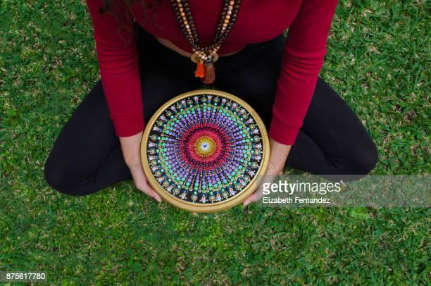 Woman's hands holding a mandala