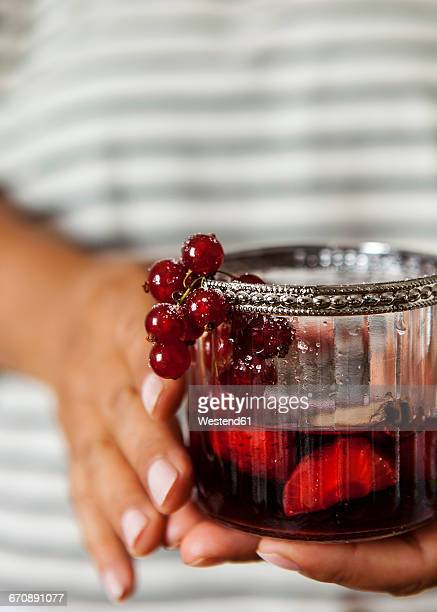 woman's hands holding glass of sangria - sangria stock pictures, royalty-free photos & images