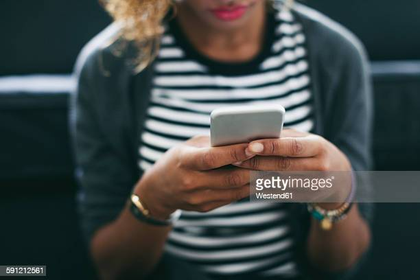 Womans hands holding smartphone