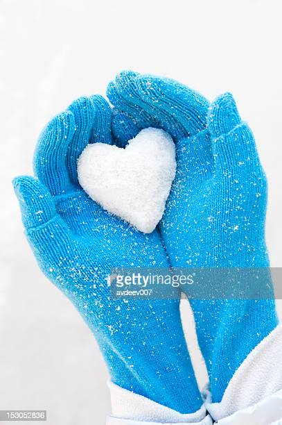 woman's hands holding snowheart - mitten stock pictures, royalty-free photos & images